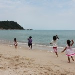 kids running wild on beach